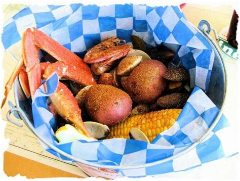 mad beach fish house seafood bucket with snow crab shrimp mussels clams and corn on the cobb picture
