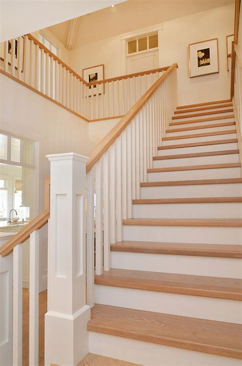 wood plank tile on staircase with white painted railings ideas something s gotta give inspired home home bunch