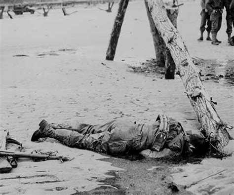 film fallen soldiers crossed rifles in the sand placed as a tribute to this