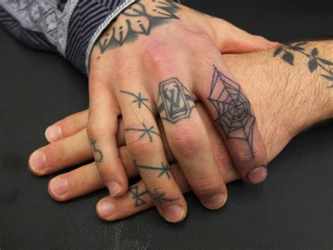 tattoo on middle finger meaning facts about finger tattoos designs and tattoos with meanings