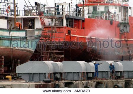 spray painter cape town spray painting ship in dock stock photo royalty free