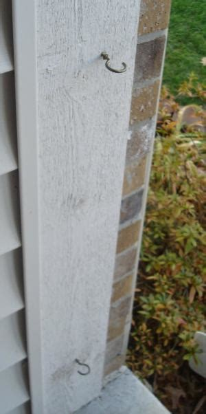 How To Hang Garland Around Front Door Outdoor Decorations Use A Tension Rod Between Front Door Jams To Hang