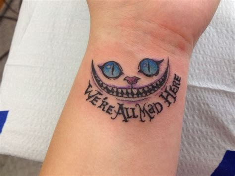 chesire cat tattoo we are all mad here cheshire cat on left wrist