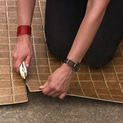 cut vinyl flooring bob vila