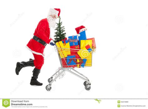 santa claus running with shopping cart stock photo image
