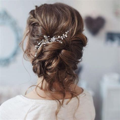 loose curl hairstyles for weddings this beautiful loose curl bridal updo hairstyle perfect
