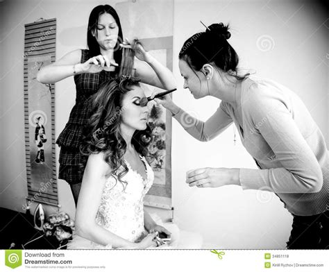 10 best wedding hair and makeup artists in rochester ny makeup artist and hairdresser preparing bride for wedding
