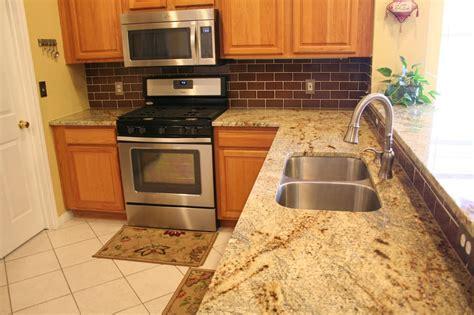 Kitchen Colors With Oak Cabinets jaguar granite countertop yelp