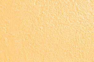 peach or light orange colored painted wall texture picture