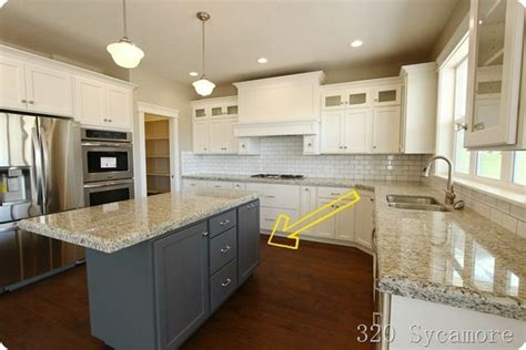 kitchen island different color than cabinets