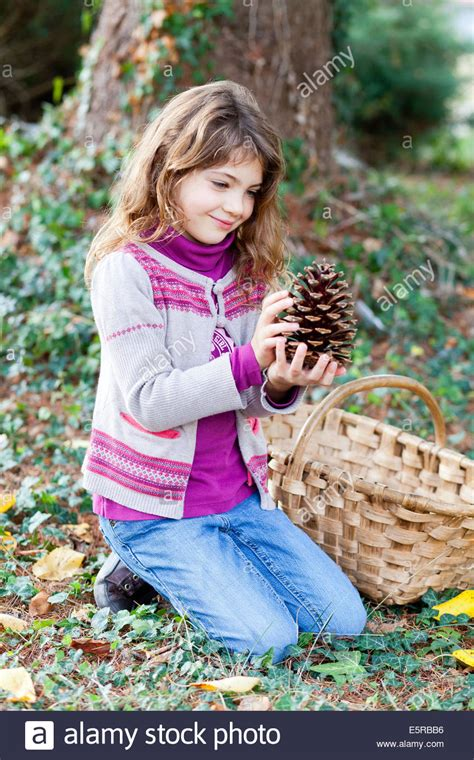 7 year old girl stock photo 7 year old girl picking up pine cones stock photo royalty