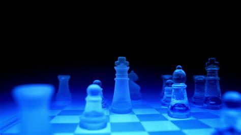 futuristic chess set tracking shot playing on a blue futuristic glass chess