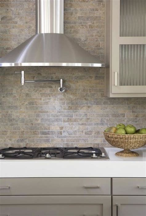 kitchens pot filler tumbled linear stone tiles backsplash taupe gray kitchen cabinets white