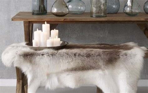 faux reindeer rug sorry rudolph i might be warming to this reindeer rug trend bench decorating and fur