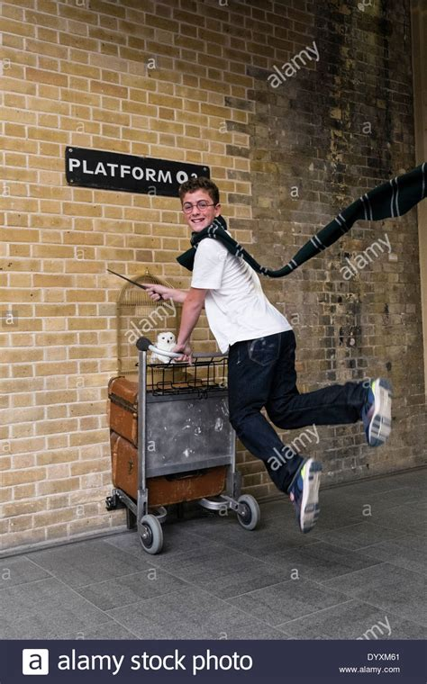 Kaos Harry Potter Harry Potter Platform 9 And 3 4 Graphics Lengan Panj harry potter fan jumping at platform 9 3 4 at king s cross station in stock photo royalty free