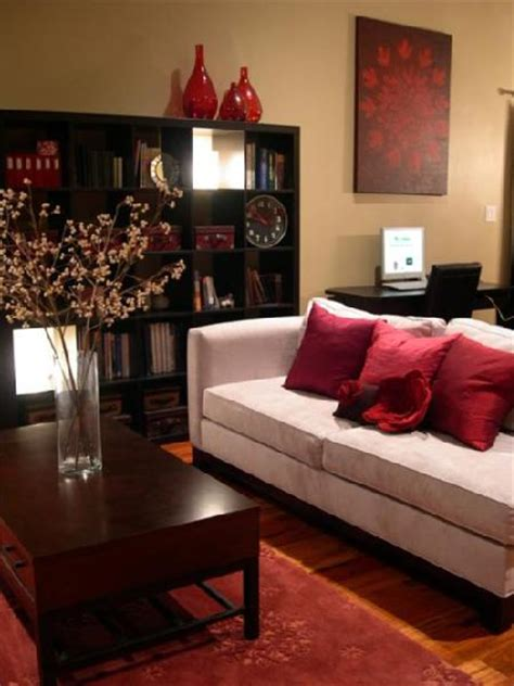 red and black living room hgtv s rms cozy bright living room gray velvet sofa red
