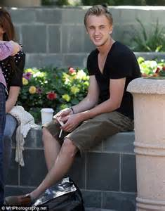 planet of the apes star tom felton enjoys a cigarette with