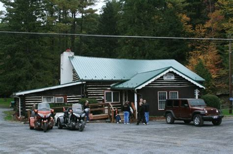 log cabin inn with our bikes parked out front i picture