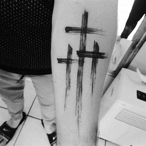 most popular cross tattoos guys inner forearm simple christian paint brush stroke