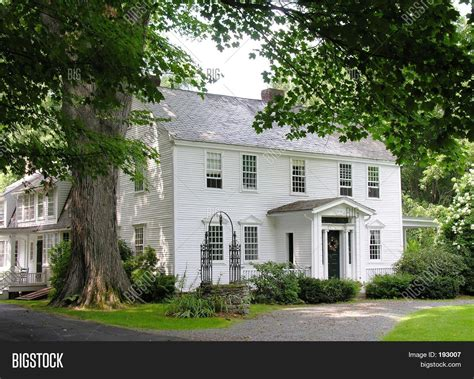 white colonial house white colonial home stock photo stock images bigstock