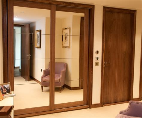 Wood Wardrobe With Mirror Fitted Wardrobes In Walnut With Mirrored Panels