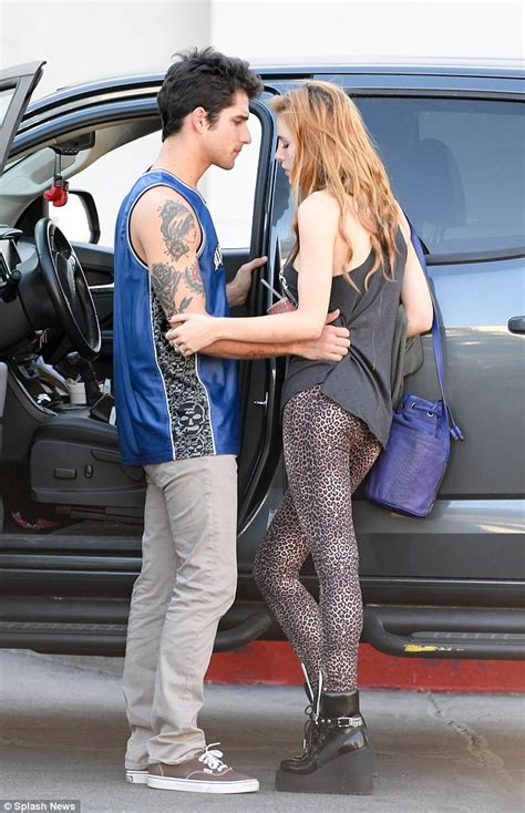 bella thorne rocks fierce leopard print leggings as she