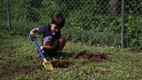 Digging On by Child Digging A In The Ground Stock Footage