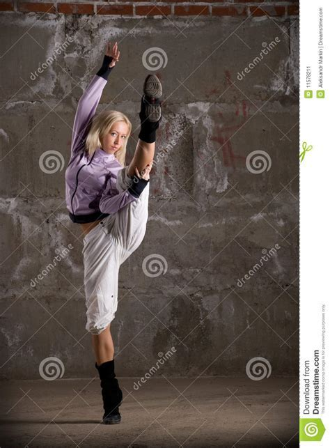 Hip Hop Girl Dancing Over Grey Brick Wal Stock Image