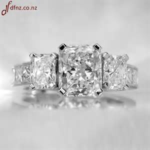 Three radiant diamond engagement ring with channel set princess