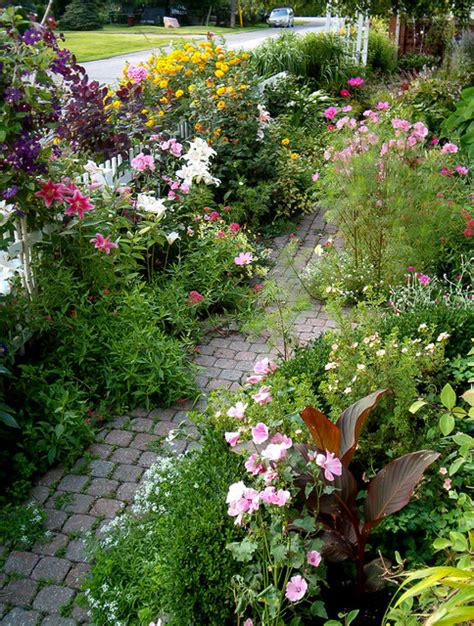 garden path bursting with blooms traditional landscape
