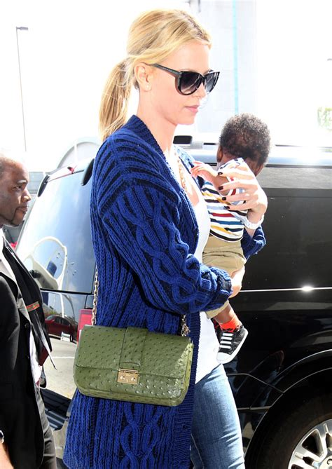 Charlize Theron With And Balenciaga Purses by The Many Bags Of Purseblog