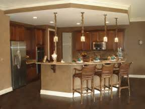 Open Kitchen Floor Plans With Islands Pendant Lights Brown Marble Top Kitchen Counter Bar Island With Wooden Stools As