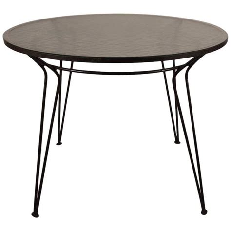 glass top iron dining table wrought iron table with textured glass top after salterini