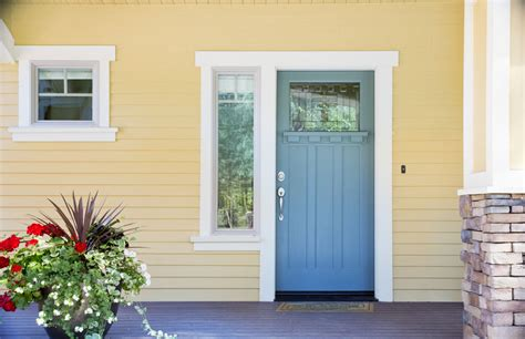 yellow house with blue door front door colors paint ideas color meanings