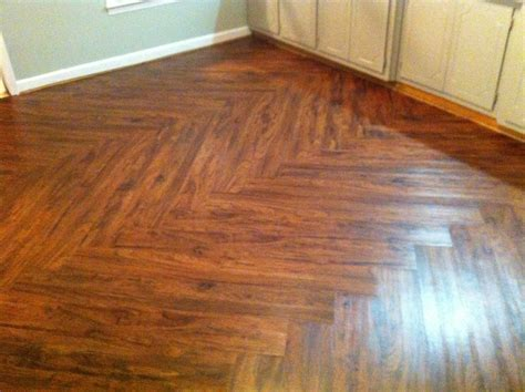 cherry vinyl plank flooring with zig zag pattern