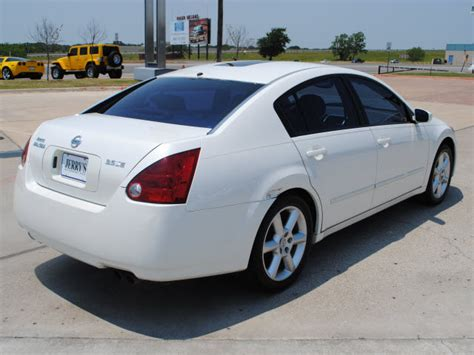 white nissan maxima 2005 301 moved permanently
