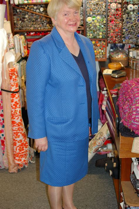 bright blue worsted wool skirt suit with matching bag