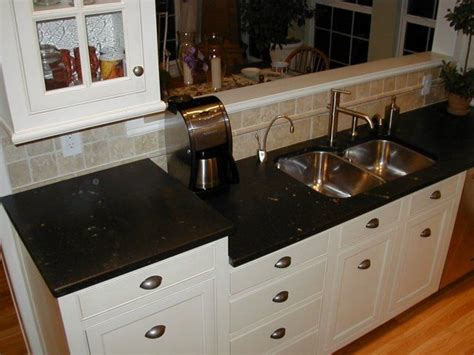 Cutting Soapstone Countertops - taller crop could add cutting board pull out above dw