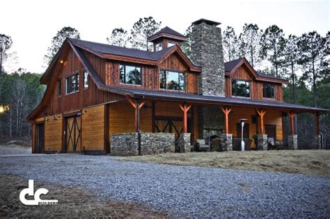 Two Barns House traditional looking newnan barn home with rustic finish