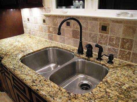 Kitchen Faucets For Granite Countertops black granite kitchen sink with bronze faucet sink black