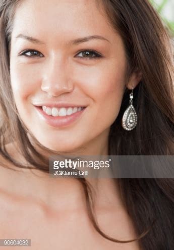 mixed race woman smiling stock photo | getty images