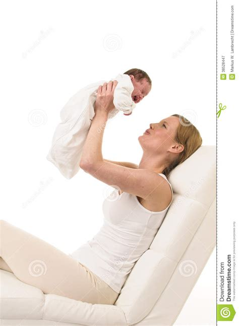 baby on couch mother with baby on the couch royalty free stock