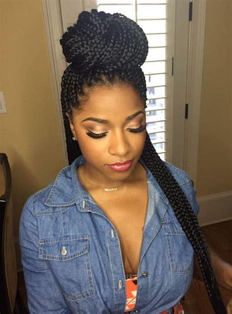pictures of long single braids in a bun with side swoop best 25 box braids bun ideas on pinterest box braids