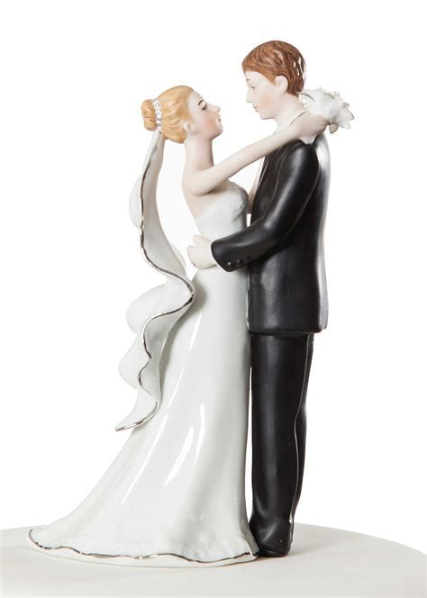 White and Silver Porcelain Bride and Groom Wedding Cake