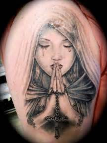praying hands religious madonna tattoo by tattoo helbeck