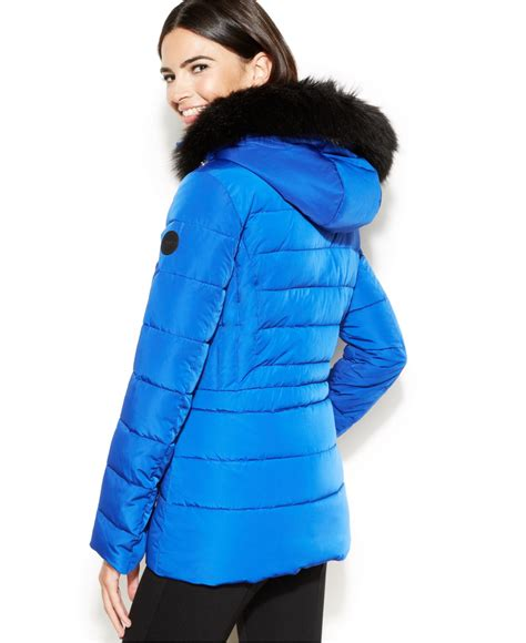 Calvin Klein Hooded Faux Fur Trim Quilted Puffer Coat by Calvin Klein Hooded Faux Fur Trim Quilted Puffer Coat In