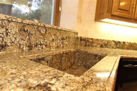 minsk gold kitchen with an awesome custom granite sink