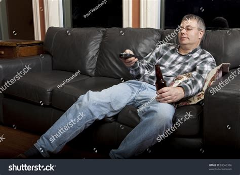 couch potato tv show couch potato watching tv drinking beer stock photo
