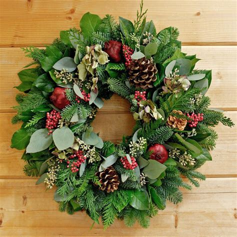 holiday wreath pomegranate holiday wreath mixed with pine cones and berries