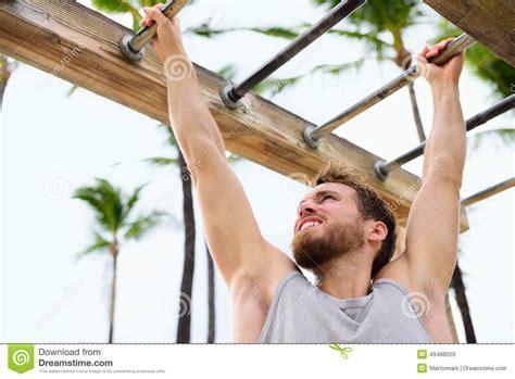 swinging bars exercise fitness athlete exercising on monkey bars stock